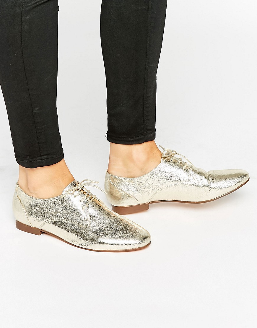 Mission Lace Up Flat Shoes Gold - predominant colour: gold; occasions: casual; material: faux leather; heel height: flat; toe: round toe; style: brogues; finish: metallic; pattern: plain; season: a/w 2016