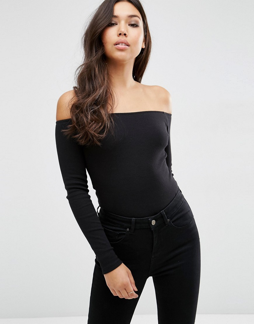 Long Sleeve Off Shoulder Top In Rib Black - neckline: off the shoulder; pattern: plain; predominant colour: black; occasions: evening; length: standard; style: top; fibres: cotton - stretch; fit: tight; sleeve length: long sleeve; sleeve style: standard; texture group: jersey - clingy; pattern type: fabric; season: a/w 2016