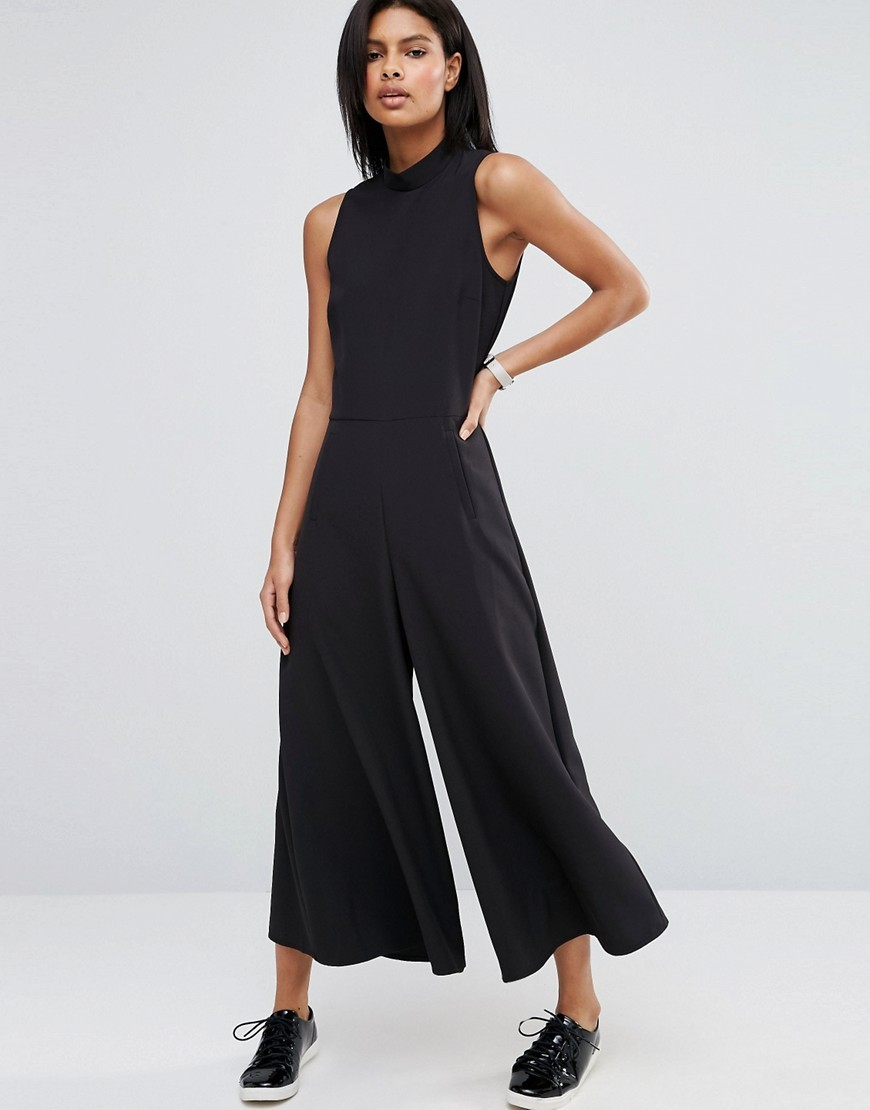 Jumpsuit With Culotte Leg And High Neck Black - pattern: plain; sleeve style: sleeveless; neckline: high neck; predominant colour: black; occasions: evening; length: calf length; fit: body skimming; fibres: polyester/polyamide - 100%; sleeve length: sleeveless; style: jumpsuit; pattern type: fabric; texture group: jersey - stretchy/drapey; season: a/w 2016