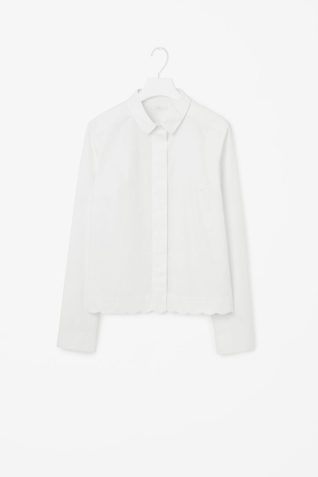 Shirt With Scalloped Hem - neckline: shirt collar/peter pan/zip with opening; pattern: plain; style: shirt; predominant colour: white; occasions: work, creative work; length: standard; fibres: cotton - 100%; fit: straight cut; sleeve length: long sleeve; sleeve style: standard; texture group: cotton feel fabrics; pattern type: fabric; wardrobe: basic; season: a/w 2016