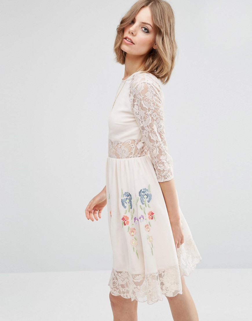 Premium Skater Dress With Lace Sleeves And Neon Embroidery Nude - sleeve style: sleeveless; predominant colour: white; occasions: evening; length: on the knee; fit: fitted at waist & bust; style: fit & flare; fibres: polyester/polyamide - 100%; neckline: crew; sleeve length: 3/4 length; pattern type: fabric; pattern: patterned/print; texture group: jersey - stretchy/drapey; embellishment: embroidered; shoulder detail: sheer at shoulder; season: a/w 2016; wardrobe: event