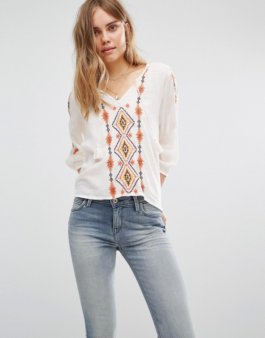 Cold Shoulder Boho Top With Embroidery White - neckline: v-neck; predominant colour: white; secondary colour: true red; occasions: casual; length: standard; style: top; fibres: viscose/rayon - 100%; fit: body skimming; sleeve length: 3/4 length; sleeve style: standard; pattern type: fabric; pattern: patterned/print; texture group: jersey - stretchy/drapey; embellishment: embroidered; multicoloured: multicoloured; season: a/w 2016; wardrobe: highlight
