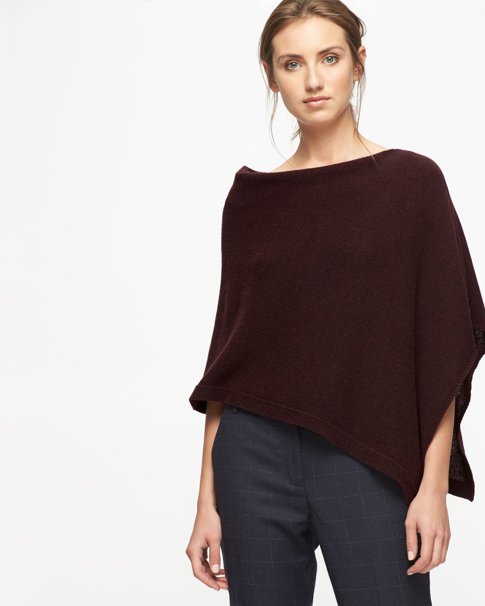 Knitted Ribbed Border Poncho - neckline: slash/boat neckline; pattern: plain; style: poncho; predominant colour: black; occasions: casual; length: standard; fibres: wool - mix; fit: slim fit; sleeve length: 3/4 length; texture group: knits/crochet; pattern type: fabric; sleeve style: cape/poncho sleeve; season: a/w 2016; wardrobe: highlight