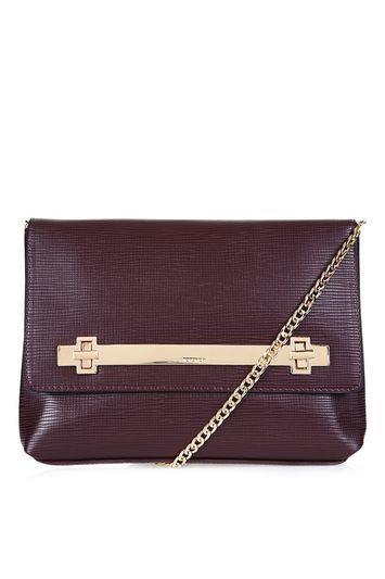Solid Lock Cable Clutch - predominant colour: burgundy; occasions: evening, occasion; type of pattern: standard; style: shoulder; length: shoulder (tucks under arm); size: small; material: faux leather; pattern: plain; finish: plain; season: s/s 2016; wardrobe: event