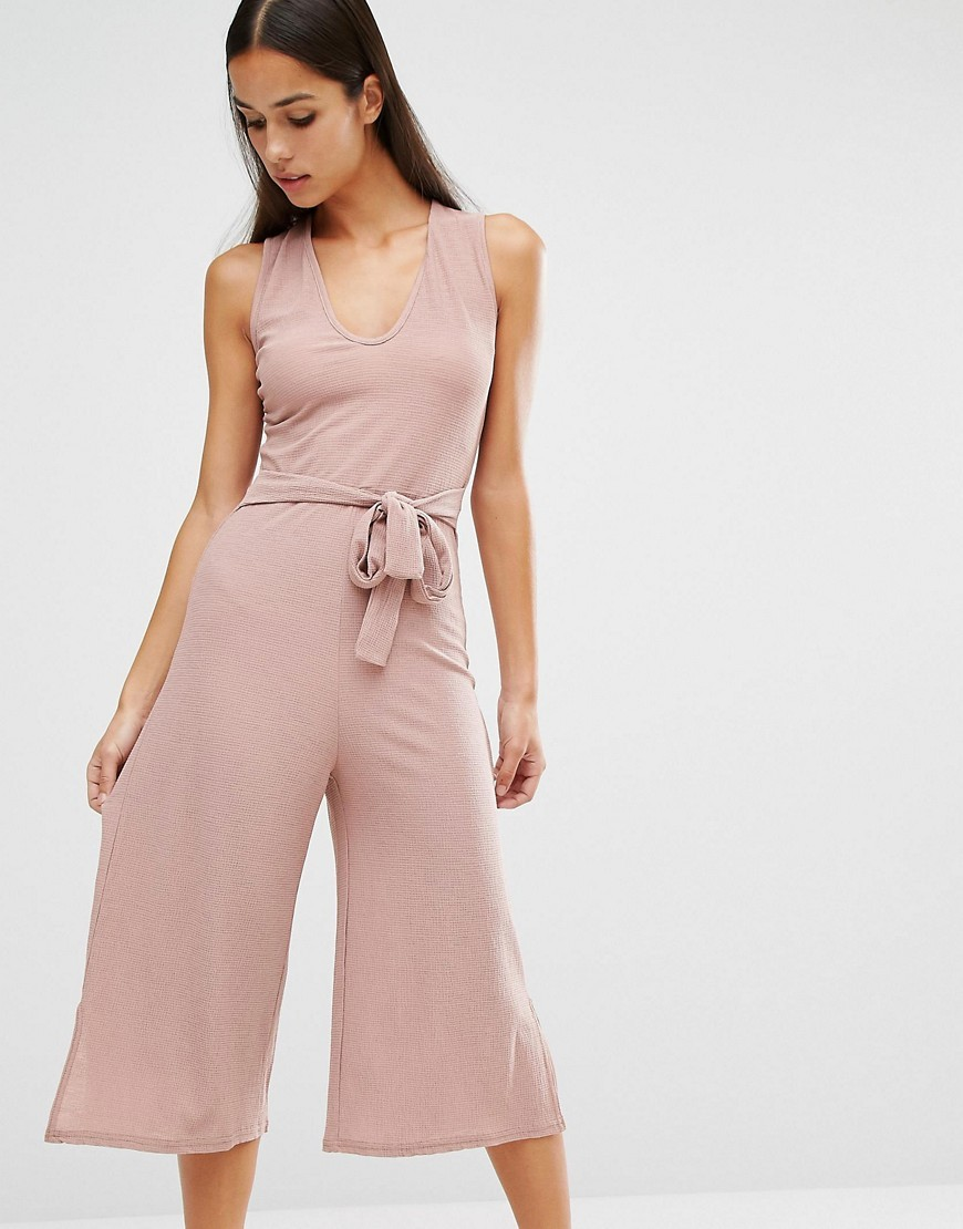 Belted Culotte Jumpsuit Pink - neckline: v-neck; pattern: plain; sleeve style: sleeveless; waist detail: belted waist/tie at waist/drawstring; predominant colour: blush; occasions: evening; length: calf length; fit: body skimming; fibres: polyester/polyamide - 100%; sleeve length: sleeveless; style: jumpsuit; pattern type: fabric; texture group: jersey - stretchy/drapey; season: a/w 2016; wardrobe: event