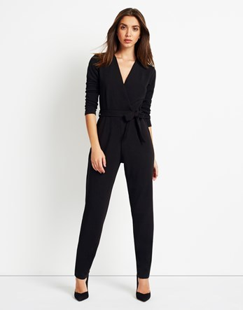 Long Sleeve Wrap Front Jumpsuit - length: standard; neckline: v-neck; pattern: plain; waist detail: belted waist/tie at waist/drawstring; predominant colour: black; occasions: evening; fit: body skimming; fibres: polyester/polyamide - stretch; hip detail: adds bulk at the hips; sleeve length: long sleeve; sleeve style: standard; style: jumpsuit; pattern type: fabric; texture group: jersey - stretchy/drapey; season: a/w 2016; wardrobe: event