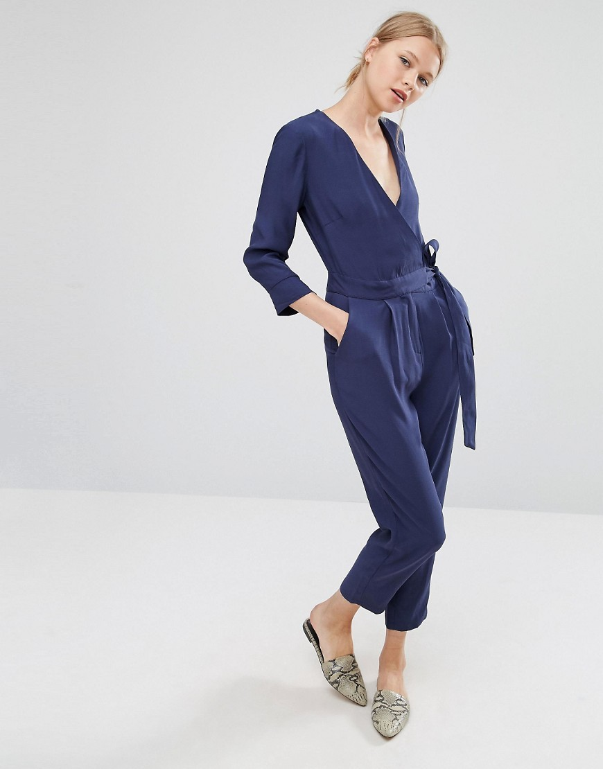 Belted Jumpsuit With Wrap Front Navy - neckline: low v-neck; pattern: plain; waist detail: belted waist/tie at waist/drawstring; predominant colour: navy; occasions: evening; length: calf length; fit: body skimming; fibres: viscose/rayon - 100%; sleeve length: 3/4 length; sleeve style: standard; style: jumpsuit; pattern type: fabric; texture group: other - light to midweight; season: a/w 2016