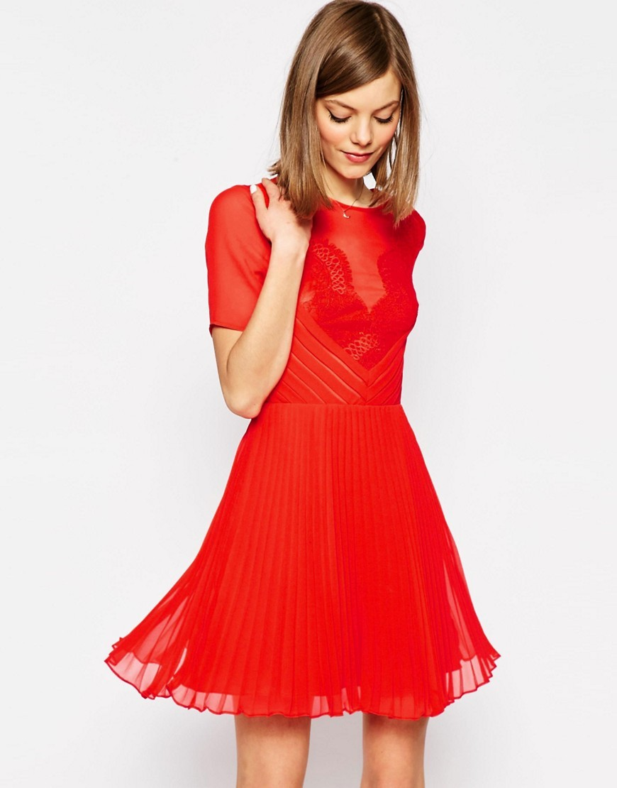 Lace And Pleat Skater Mini Dress Red - pattern: plain; bust detail: sheer at bust; predominant colour: true red; occasions: evening; length: just above the knee; fit: fitted at waist & bust; style: fit & flare; fibres: polyester/polyamide - 100%; neckline: crew; sleeve length: short sleeve; sleeve style: standard; texture group: lace; pattern type: fabric; pattern size: standard; season: a/w 2016; wardrobe: event