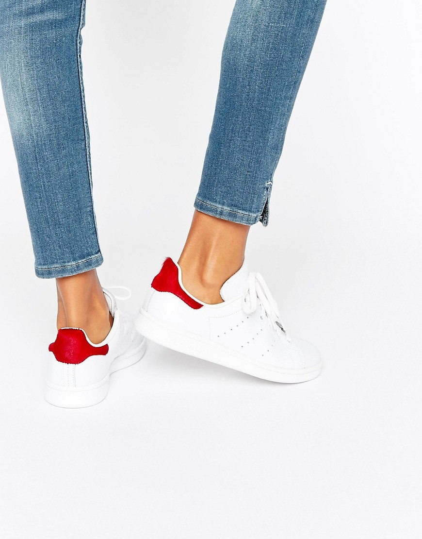 Stan Smith White - predominant colour: white; occasions: casual; material: leather; heel height: flat; toe: round toe; style: trainers; finish: plain; pattern: plain; wardrobe: basic; season: a/w 2016