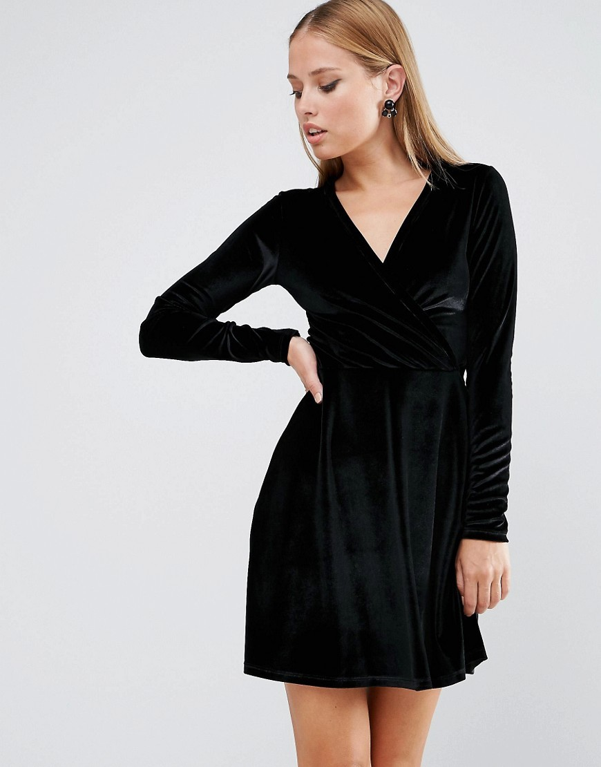 Wrap Skater Dress In Velvet Black - style: faux wrap/wrap; length: mini; neckline: v-neck; pattern: plain; predominant colour: black; occasions: evening; fit: body skimming; fibres: polyester/polyamide - stretch; sleeve length: long sleeve; sleeve style: standard; pattern type: fabric; texture group: velvet/fabrics with pile; season: a/w 2016; wardrobe: event
