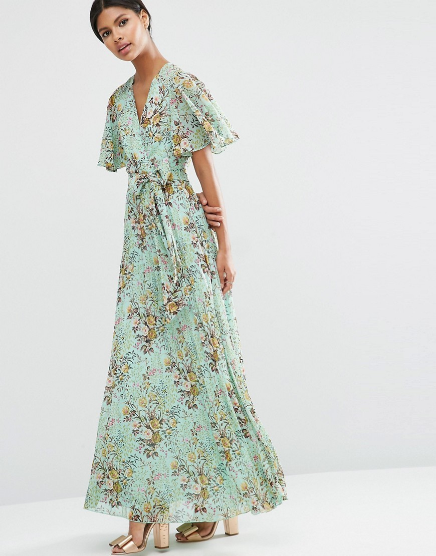 Pleated Maxi Dress In Green Base Floral Dress Multi - neckline: v-neck; fit: loose; style: maxi dress; waist detail: belted waist/tie at waist/drawstring; predominant colour: pistachio; secondary colour: nude; occasions: evening; length: floor length; fibres: polyester/polyamide - 100%; sleeve length: half sleeve; sleeve style: standard; texture group: cotton feel fabrics; pattern type: fabric; pattern size: big & busy; pattern: patterned/print; multicoloured: multicoloured; season: a/w 2016; wardrobe: event
