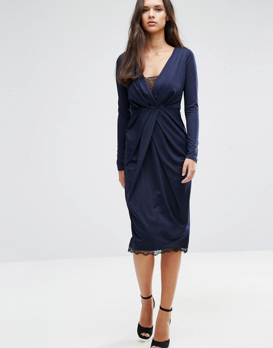 Pencil Wrap Dress With Lace Hem And Lace Insert Navy - style: faux wrap/wrap; length: below the knee; neckline: low v-neck; pattern: plain; predominant colour: navy; occasions: evening; fit: body skimming; fibres: polyester/polyamide - stretch; sleeve length: long sleeve; sleeve style: standard; pattern type: fabric; texture group: jersey - stretchy/drapey; embellishment: lace; season: a/w 2016