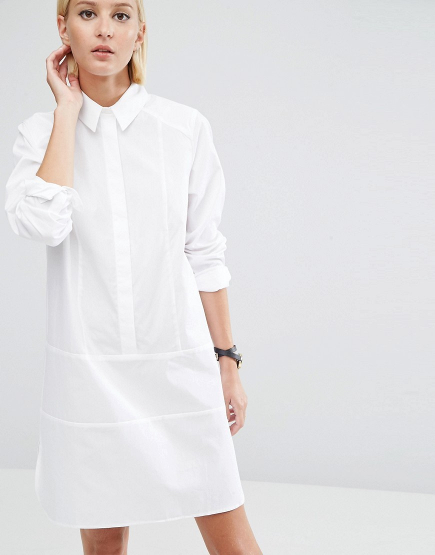 Cotton Shirt Dress With Seam Detail White - style: shirt; neckline: shirt collar/peter pan/zip with opening; pattern: plain; predominant colour: white; occasions: casual, creative work; length: just above the knee; fit: body skimming; fibres: cotton - 100%; sleeve length: long sleeve; sleeve style: standard; texture group: cotton feel fabrics; pattern type: fabric; wardrobe: basic; season: a/w 2016