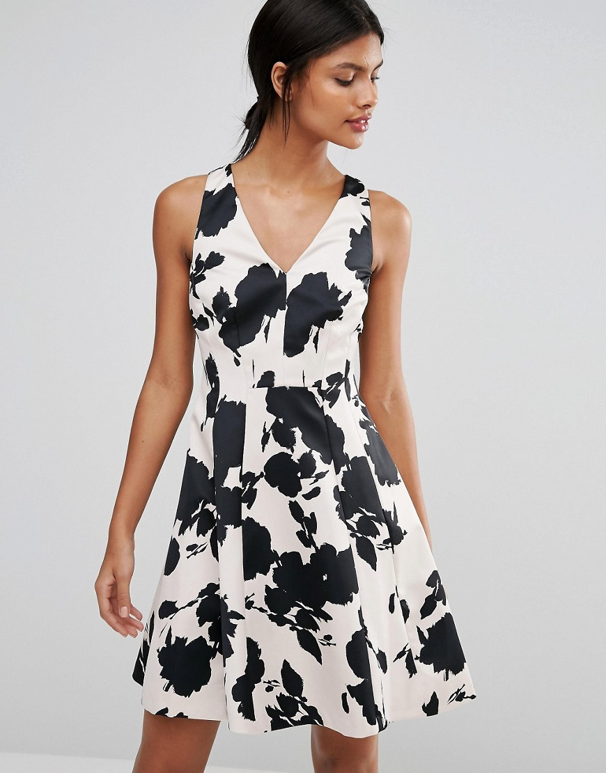 Belize Print Skater Dress Multi - neckline: v-neck; sleeve style: sleeveless; predominant colour: white; secondary colour: black; occasions: evening; length: just above the knee; fit: fitted at waist & bust; style: fit & flare; fibres: polyester/polyamide - 100%; sleeve length: sleeveless; pattern type: fabric; pattern size: big & busy; pattern: florals; texture group: jersey - stretchy/drapey; multicoloured: multicoloured; season: a/w 2016; wardrobe: event