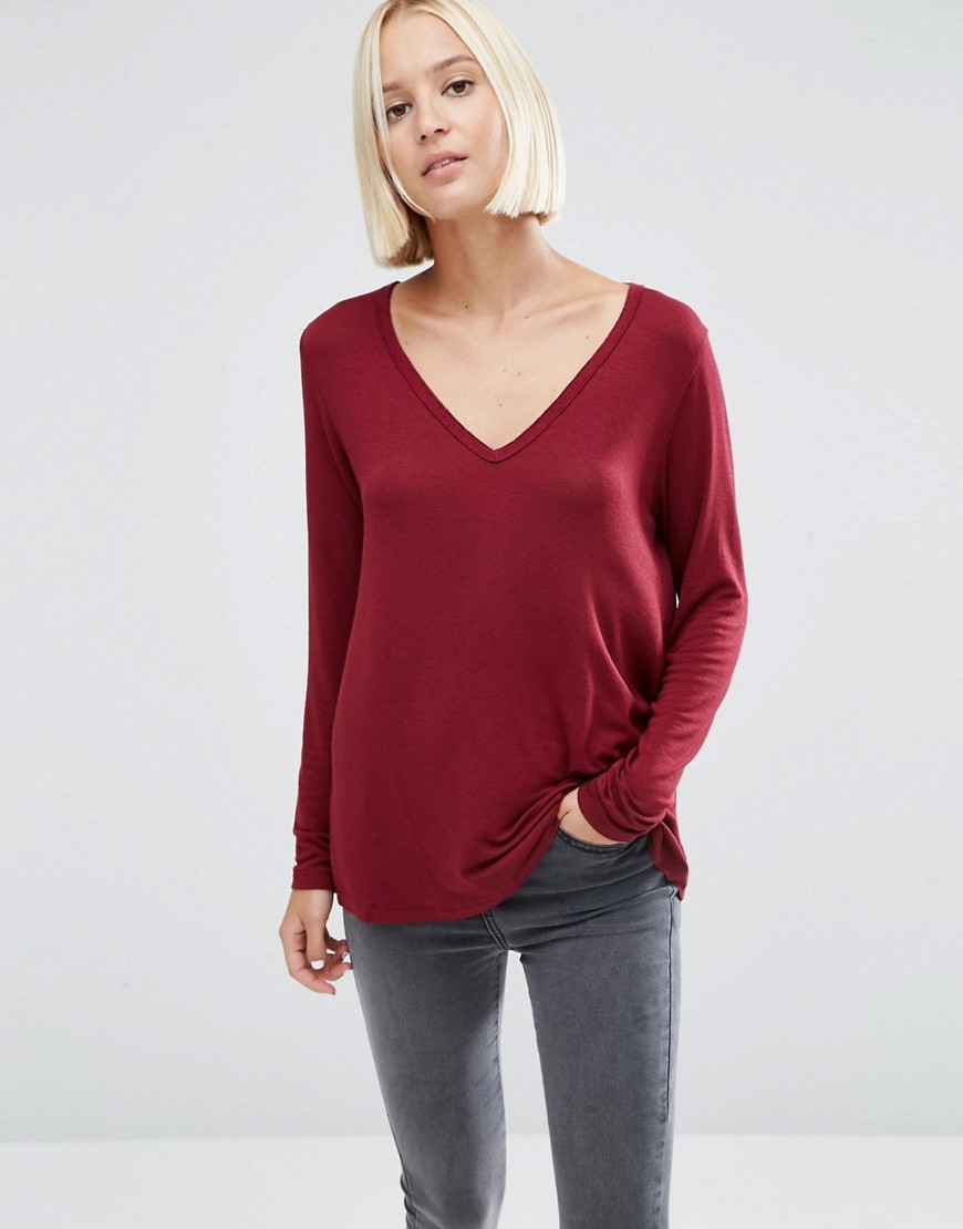 The New Forever T Shirt With Long Sleeves And Dip Back Red - neckline: low v-neck; pattern: plain; style: t-shirt; occasions: casual, creative work; length: standard; fibres: viscose/rayon - stretch; fit: loose; sleeve length: long sleeve; sleeve style: standard; pattern type: fabric; texture group: jersey - stretchy/drapey; predominant colour: raspberry; season: a/w 2016; wardrobe: highlight