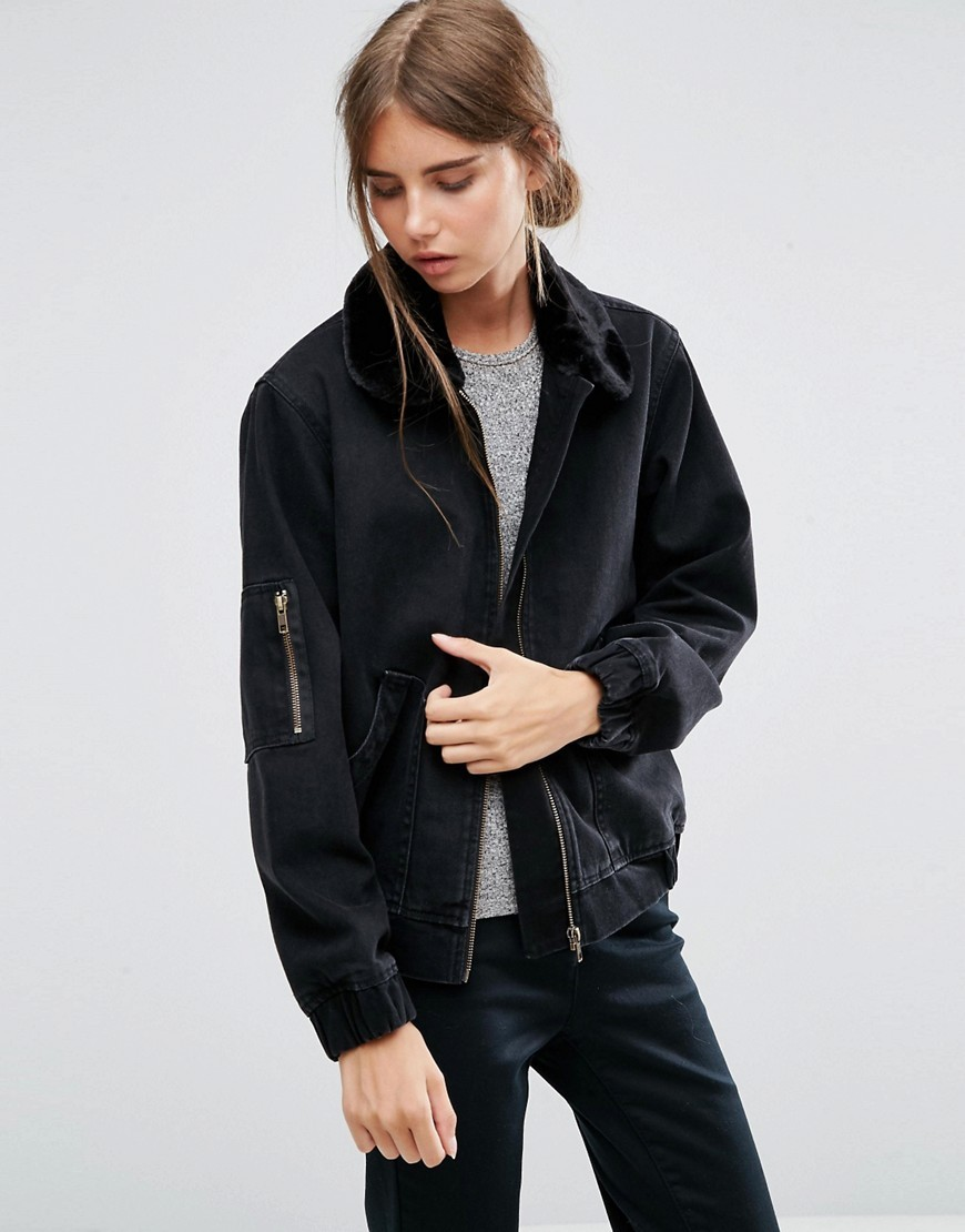 Denim Bomber Jacket In Washed Black With Faux Fur Collar Black - pattern: plain; collar: round collar/collarless; style: bomber; predominant colour: black; occasions: casual; length: standard; fit: straight cut (boxy); fibres: cotton - mix; sleeve length: long sleeve; sleeve style: standard; texture group: denim; collar break: high; pattern type: fabric; embellishment: fur; season: a/w 2016; wardrobe: highlight