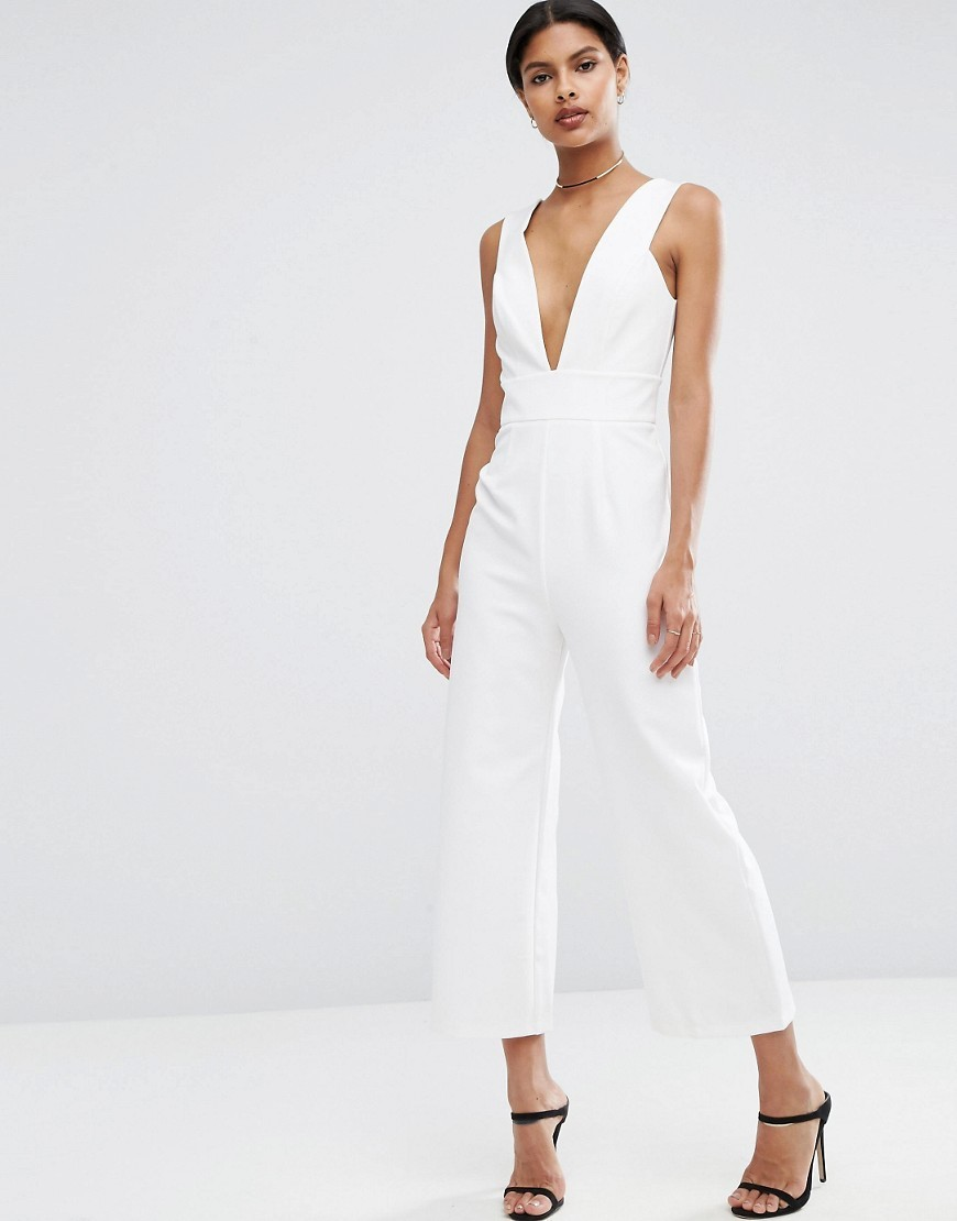 Structured Plunge Jumpsuit With Culotte Leg Ivory - length: standard; neckline: plunge; pattern: plain; sleeve style: sleeveless; predominant colour: ivory/cream; occasions: evening; fit: body skimming; fibres: polyester/polyamide - 100%; sleeve length: sleeveless; style: jumpsuit; pattern type: fabric; texture group: other - light to midweight; season: a/w 2016; wardrobe: event