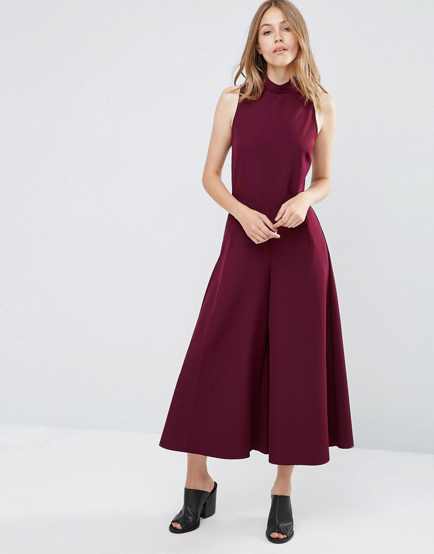 Jumpsuit With Culotte Leg And High Neck Wine - pattern: plain; sleeve style: sleeveless; neckline: high neck; predominant colour: burgundy; occasions: evening; length: calf length; fit: body skimming; fibres: polyester/polyamide - 100%; sleeve length: sleeveless; style: jumpsuit; pattern type: fabric; texture group: jersey - stretchy/drapey; season: a/w 2016; wardrobe: event