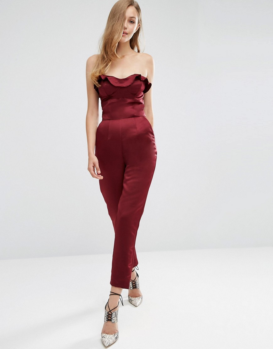 Satin Ruffle Bandeau Jumpsuit Wine - length: standard; neckline: strapless (straight/sweetheart); pattern: plain; sleeve style: strapless; predominant colour: burgundy; occasions: evening; fit: body skimming; fibres: polyester/polyamide - 100%; sleeve length: sleeveless; texture group: structured shiny - satin/tafetta/silk etc.; style: jumpsuit; bust detail: bulky details at bust; pattern type: fabric; season: a/w 2016; wardrobe: event