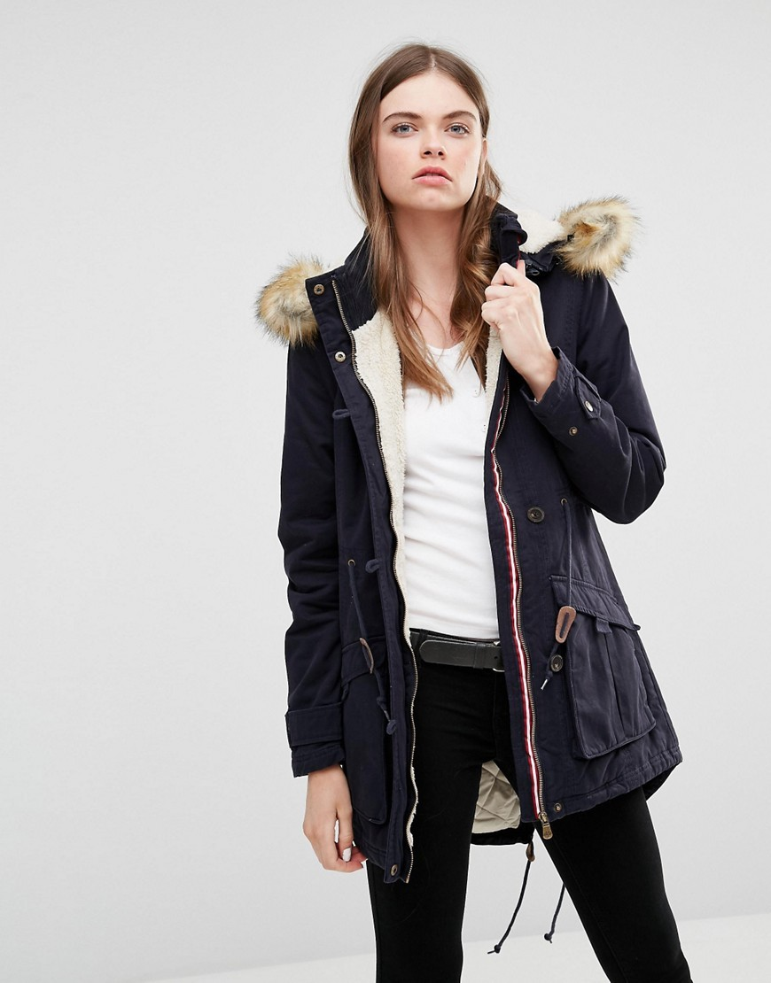 Navy Parka With Faux Fur Trim Hood Navy - pattern: plain; collar: funnel; fit: loose; style: parka; length: mid thigh; predominant colour: navy; occasions: casual; fibres: polyester/polyamide - 100%; sleeve length: long sleeve; sleeve style: standard; texture group: technical outdoor fabrics; collar break: high; pattern type: fabric; wardrobe: basic; season: a/w 2016