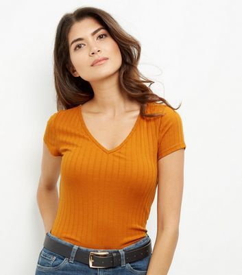 Mustard V Neck Cap Sleeve T Shirt - neckline: v-neck; pattern: plain; style: t-shirt; predominant colour: bright orange; occasions: casual; length: standard; fibres: polyester/polyamide - stretch; fit: body skimming; sleeve length: short sleeve; sleeve style: standard; pattern type: fabric; texture group: jersey - stretchy/drapey; season: a/w 2016; wardrobe: highlight