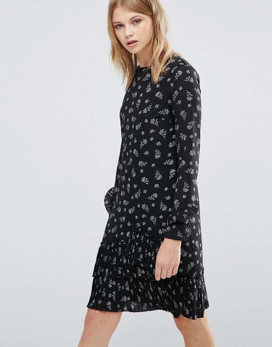 Dotty Floral Print Pleated Hem Shift Dress Black - style: shift; waist detail: drop waist; secondary colour: light grey; predominant colour: black; occasions: casual; length: just above the knee; fit: body skimming; fibres: polyester/polyamide - 100%; neckline: crew; sleeve length: long sleeve; sleeve style: standard; pattern type: fabric; pattern: florals; texture group: jersey - stretchy/drapey; multicoloured: multicoloured; season: a/w 2016; wardrobe: highlight