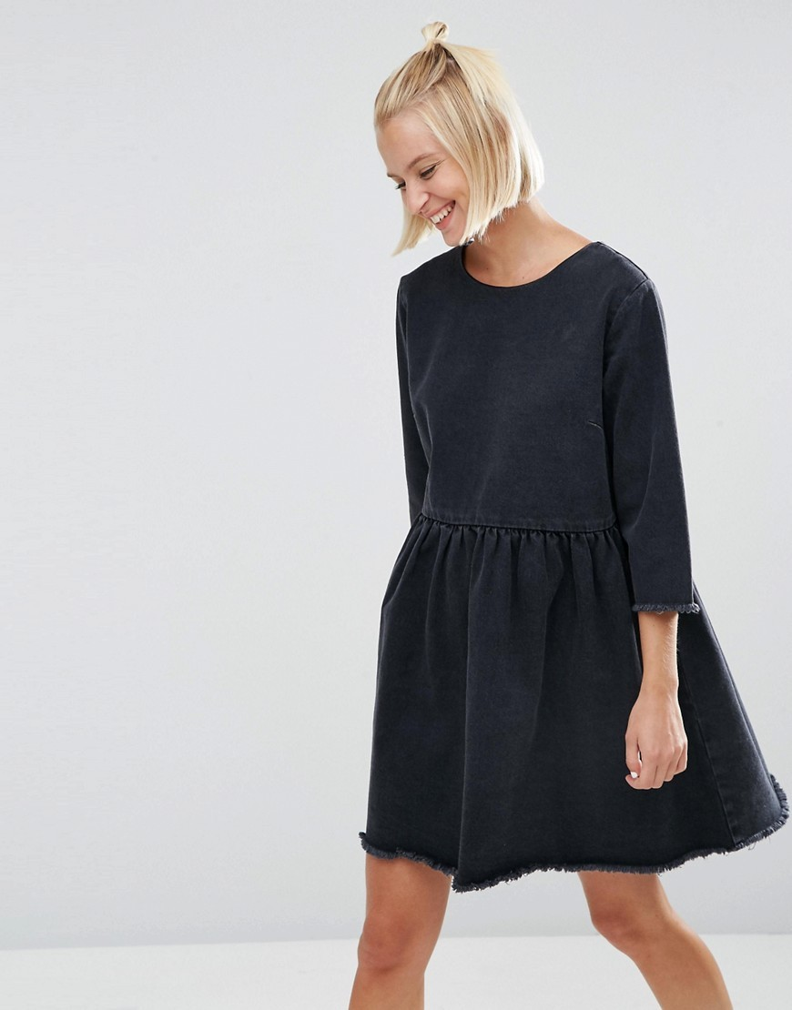 Denim Smock Dress With Raw Hem In Washed Black Washed Black - style: a-line; neckline: round neck; pattern: plain; predominant colour: black; occasions: casual, creative work; length: just above the knee; fit: soft a-line; fibres: cotton - 100%; sleeve length: 3/4 length; sleeve style: standard; pattern type: fabric; pattern size: standard; texture group: jersey - stretchy/drapey; wardrobe: basic; season: a/w 2016