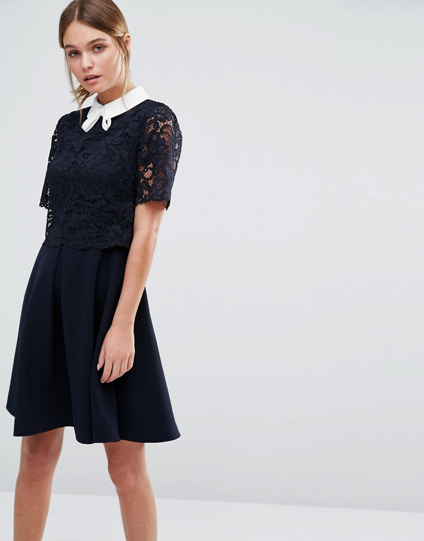 Dixxy Lace Double Layer Dress Navy - neckline: pussy bow; secondary colour: white; predominant colour: navy; occasions: evening; length: just above the knee; fit: fitted at waist & bust; style: fit & flare; fibres: polyester/polyamide - stretch; sleeve length: short sleeve; sleeve style: standard; texture group: lace; pattern type: fabric; pattern: patterned/print; embellishment: lace; season: a/w 2016; wardrobe: event; embellishment location: top