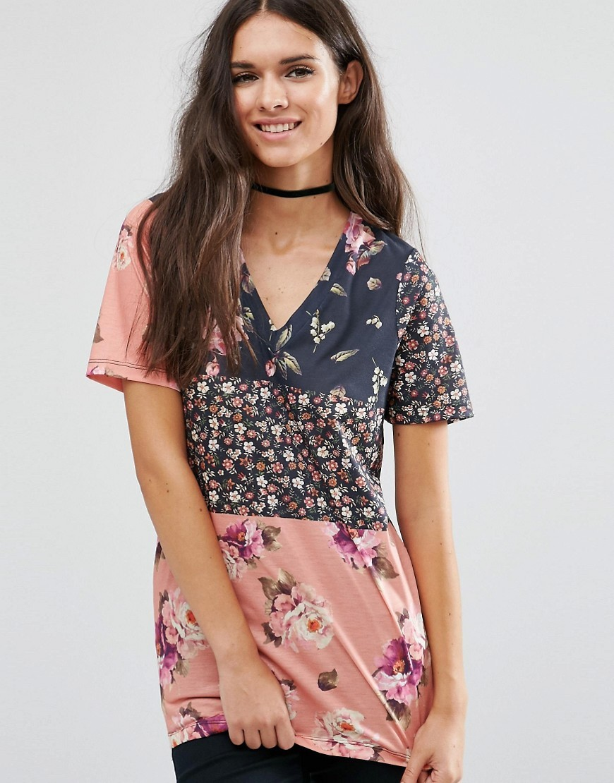T Shirt In Spliced Floral Print Multi - neckline: low v-neck; length: below the bottom; style: t-shirt; predominant colour: pink; occasions: casual; fibres: polyester/polyamide - 100%; fit: body skimming; sleeve length: half sleeve; sleeve style: standard; pattern type: fabric; pattern: florals; texture group: other - light to midweight; pattern size: big & busy (top); multicoloured: multicoloured; season: a/w 2016