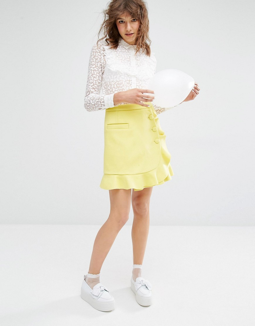 Sister Ruffle Wrap Skirt Yellow - pattern: plain; style: wrap/faux wrap; waist: high rise; predominant colour: primrose yellow; length: just above the knee; fibres: wool - mix; occasions: occasion, creative work; hip detail: adds bulk at the hips; fit: straight cut; pattern type: fabric; texture group: woven light midweight; season: a/w 2016; wardrobe: highlight