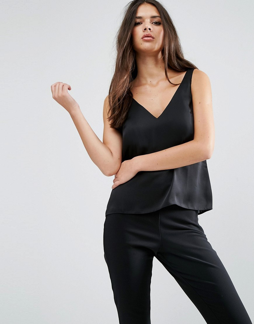 Satin Vest With Deep Plunge Black - neckline: v-neck; pattern: plain; sleeve style: sleeveless; style: vest top; predominant colour: black; occasions: casual; length: standard; fibres: polyester/polyamide - 100%; fit: body skimming; sleeve length: sleeveless; pattern type: fabric; texture group: jersey - stretchy/drapey; wardrobe: basic; season: a/w 2016