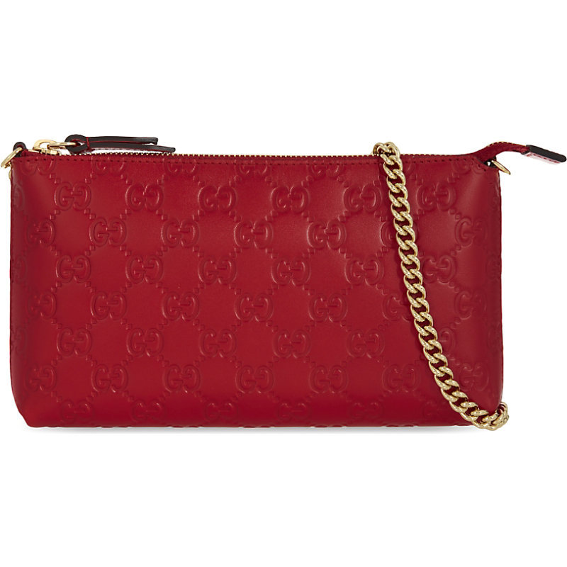 Gg Signature Embossed Leather Clutch, Women's, Hibis Red - predominant colour: true red; occasions: evening; type of pattern: standard; style: clutch; length: shoulder (tucks under arm); size: standard; material: leather; pattern: plain; finish: plain; season: a/w 2016