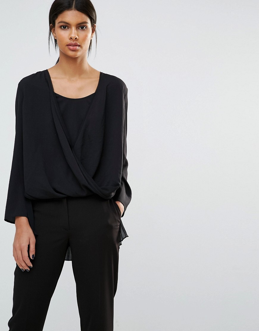 Poly Plains Pleat Back Wrap Top Black - neckline: low v-neck; pattern: plain; length: below the bottom; style: wrap/faux wrap; predominant colour: black; occasions: casual, evening; fibres: polyester/polyamide - 100%; fit: loose; sleeve length: long sleeve; sleeve style: standard; texture group: crepes; pattern type: fabric; wardrobe: basic; season: a/w 2016