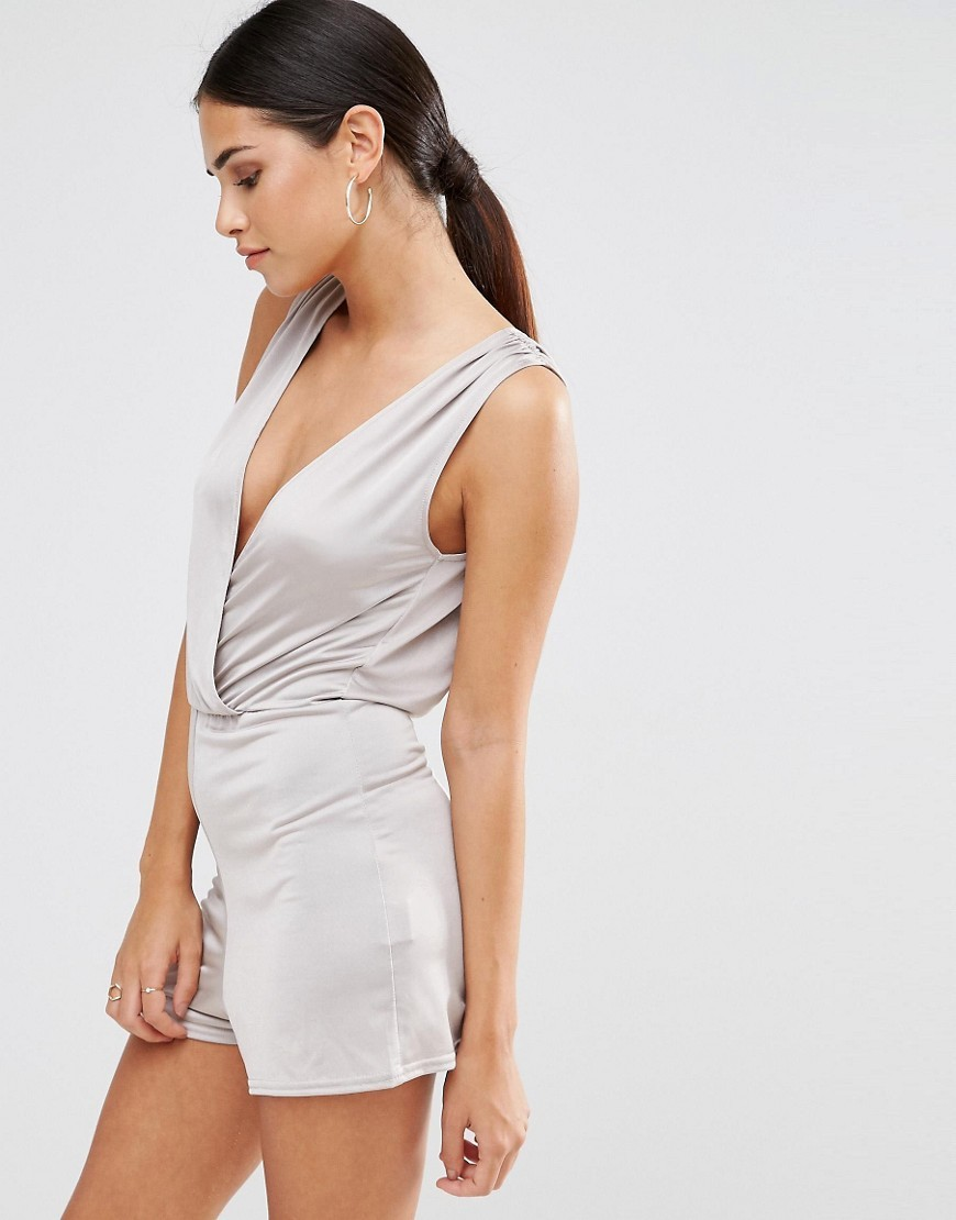 Wrap Playsuit Silver Slinky - neckline: plunge; pattern: plain; sleeve style: sleeveless; hip detail: fitted at hip; length: short shorts; predominant colour: silver; occasions: evening; fit: body skimming; fibres: polyester/polyamide - stretch; sleeve length: sleeveless; style: playsuit; pattern type: fabric; texture group: jersey - stretchy/drapey; season: a/w 2016; wardrobe: event