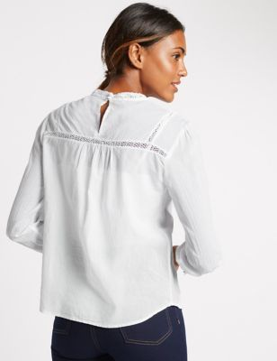 Pure Cotton Embroidered Long Sleeve Blouse - pattern: plain; neckline: high neck; sleeve style: balloon; style: blouse; bust detail: ruching/gathering/draping/layers/pintuck pleats at bust; predominant colour: white; occasions: casual, creative work; length: standard; fibres: cotton - 100%; fit: loose; sleeve length: long sleeve; pattern type: fabric; texture group: other - light to midweight; embellishment: embroidered; season: a/w 2016; wardrobe: highlight; trends: romantic explorer