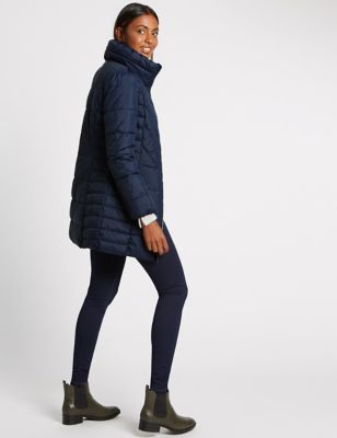 Padded & Quilted Coat With Stormwear™ - sleeve style: puffed; pattern: plain; length: below the bottom; collar: funnel; predominant colour: navy; occasions: casual, creative work; fit: straight cut (boxy); fibres: polyester/polyamide - 100%; sleeve length: long sleeve; collar break: high; pattern type: fabric; texture group: other - bulky/heavy; style: puffa; wardrobe: basic; season: a/w 2016