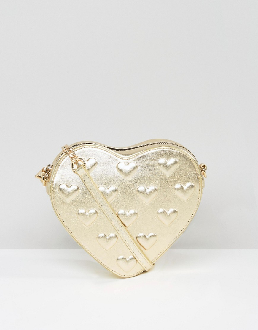 Embossed Heart Cross Body Bag Gold - predominant colour: gold; occasions: casual, creative work; type of pattern: standard; style: messenger; length: across body/long; size: standard; material: faux leather; pattern: plain; finish: metallic; season: a/w 2016; wardrobe: highlight