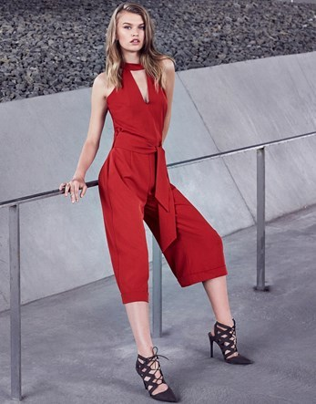 High Neck Tie Waist Jumpsuit - pattern: plain; sleeve style: sleeveless; predominant colour: true red; occasions: evening; length: calf length; fit: body skimming; neckline: peep hole neckline; fibres: polyester/polyamide - 100%; sleeve length: sleeveless; style: jumpsuit; pattern type: fabric; texture group: jersey - stretchy/drapey; season: a/w 2016; wardrobe: event