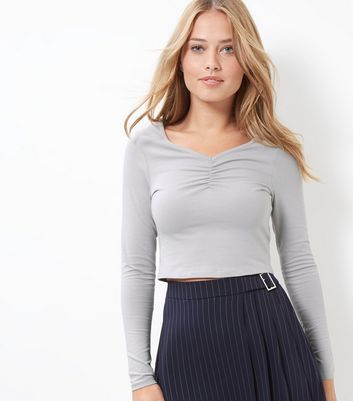 Grey Ruched Front Long Sleeve Crop Top - neckline: v-neck; pattern: plain; length: cropped; predominant colour: light grey; occasions: casual; style: top; fibres: cotton - mix; fit: body skimming; sleeve length: long sleeve; sleeve style: standard; pattern type: fabric; texture group: jersey - stretchy/drapey; wardrobe: basic; season: a/w 2016