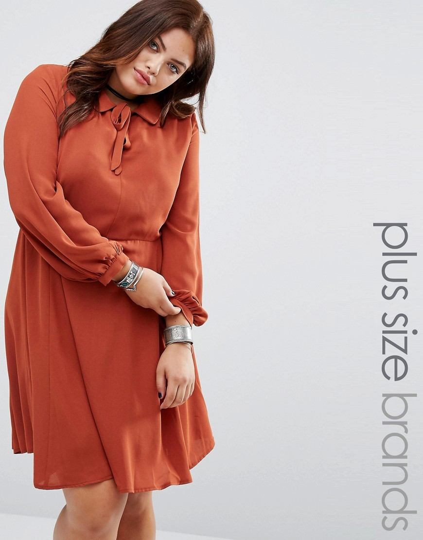 Collared Pussy Bow Dress Rust - style: shirt; pattern: plain; neckline: pussy bow; predominant colour: terracotta; occasions: evening; length: just above the knee; fit: body skimming; fibres: polyester/polyamide - 100%; sleeve length: long sleeve; sleeve style: standard; texture group: sheer fabrics/chiffon/organza etc.; pattern type: fabric; season: a/w 2016; wardrobe: event