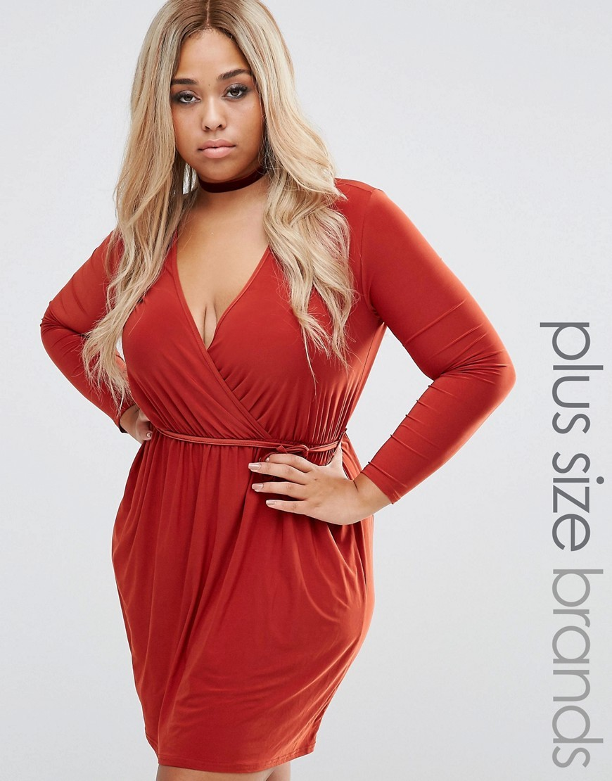 Plus Wrap Skater Dress Terrocotta - style: faux wrap/wrap; length: mid thigh; neckline: low v-neck; pattern: plain; waist detail: belted waist/tie at waist/drawstring; predominant colour: bright orange; occasions: evening; fit: body skimming; fibres: polyester/polyamide - stretch; sleeve length: long sleeve; sleeve style: standard; pattern type: fabric; texture group: jersey - stretchy/drapey; season: a/w 2016; wardrobe: event