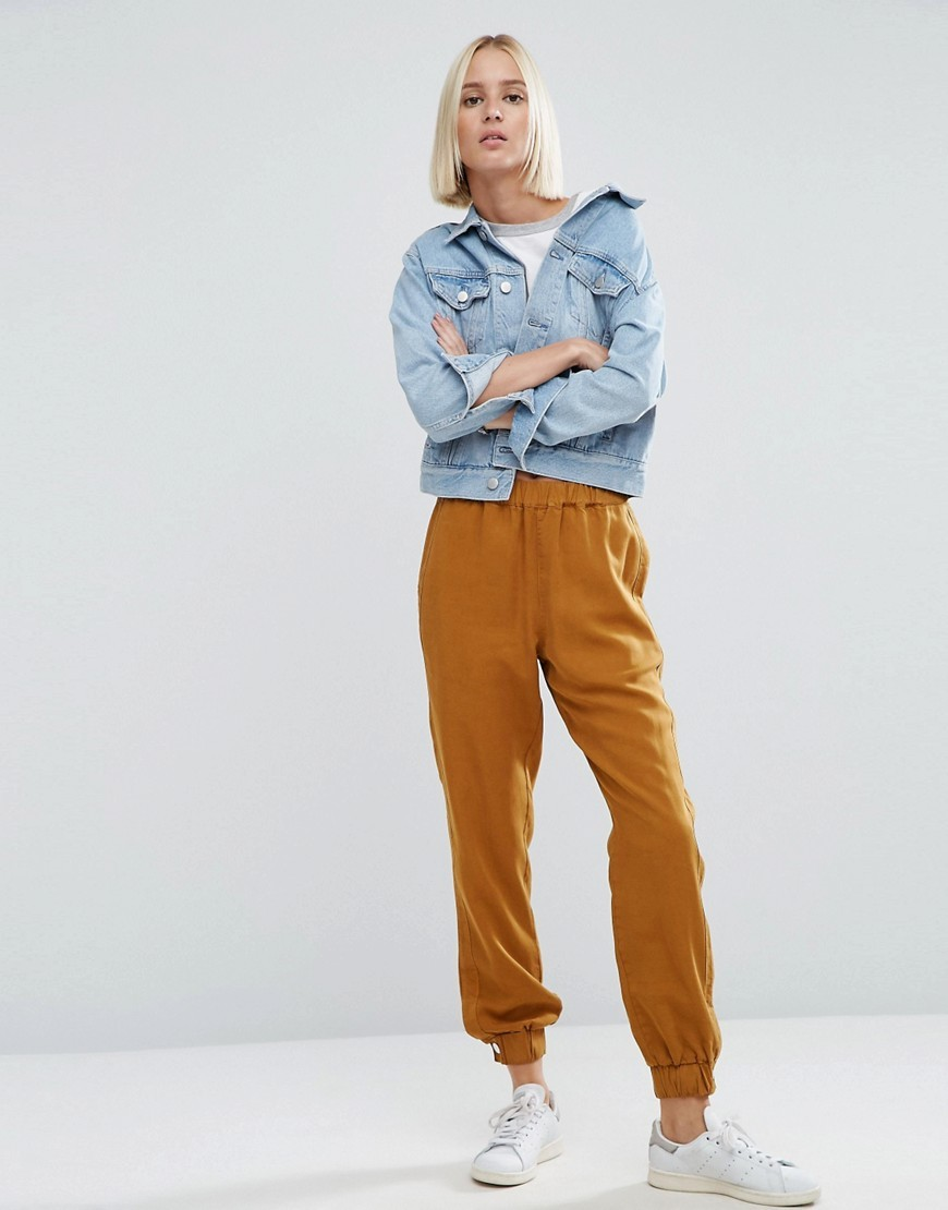 Washed Track Pant With Poppers Ocre - length: standard; pattern: plain; style: peg leg; waist: mid/regular rise; predominant colour: mustard; occasions: casual; fibres: polyester/polyamide - 100%; fit: slim leg; pattern type: fabric; texture group: woven light midweight; season: a/w 2016