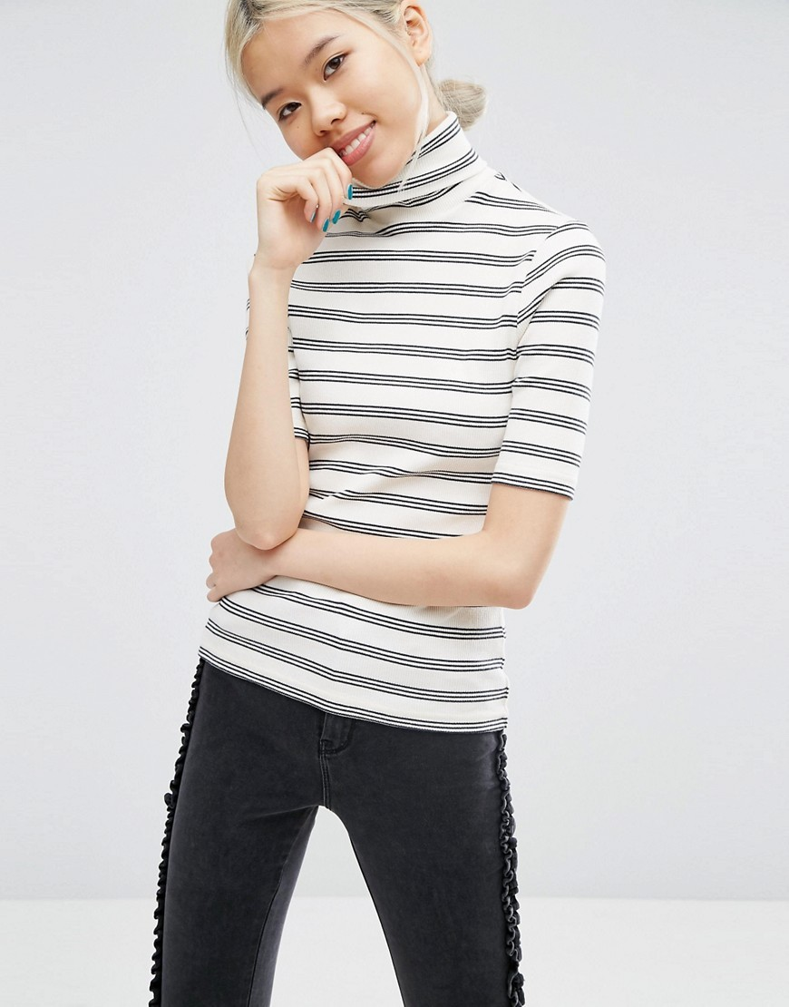 Polo Neck Top In Stripe Rib Cream/Black - pattern: horizontal stripes; neckline: roll neck; predominant colour: ivory/cream; secondary colour: mid grey; occasions: casual; length: standard; style: top; fibres: cotton - mix; fit: body skimming; sleeve length: short sleeve; sleeve style: standard; texture group: knits/crochet; pattern type: knitted - other; pattern size: standard; multicoloured: multicoloured; season: a/w 2016
