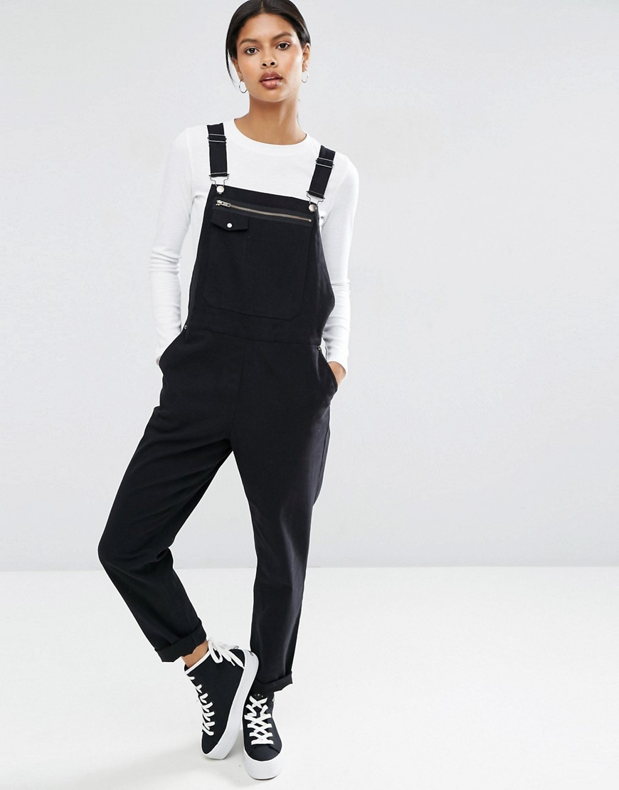 90's Dungaree With Pocket Detail And Relaxed Leg Black - length: standard; sleeve style: standard vest straps/shoulder straps; fit: loose; pattern: plain; predominant colour: black; occasions: casual; fibres: cotton - stretch; sleeve length: sleeveless; texture group: denim; style: dungarees; neckline: medium square neck; pattern type: fabric; season: a/w 2016; wardrobe: highlight
