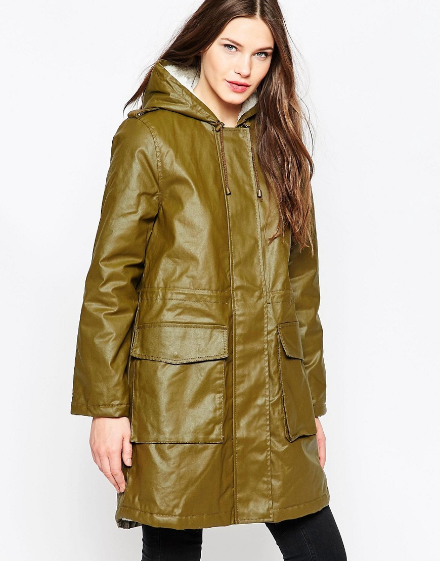 Starkey Waxed Long Line Parka Turtle - pattern: plain; fit: loose; style: parka; back detail: hood; collar: high neck; length: mid thigh; predominant colour: khaki; occasions: casual; fibres: cotton - 100%; sleeve length: long sleeve; sleeve style: standard; texture group: waxed cotton; collar break: high; pattern type: fabric; wardrobe: basic; season: a/w 2016