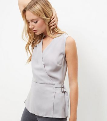 Gray Front Wrap Sleeveless Top - neckline: v-neck; pattern: plain; sleeve style: sleeveless; style: wrap/faux wrap; waist detail: belted waist/tie at waist/drawstring; predominant colour: light grey; occasions: evening; length: standard; fibres: polyester/polyamide - 100%; fit: body skimming; sleeve length: sleeveless; texture group: cotton feel fabrics; pattern type: fabric; season: a/w 2016; wardrobe: event