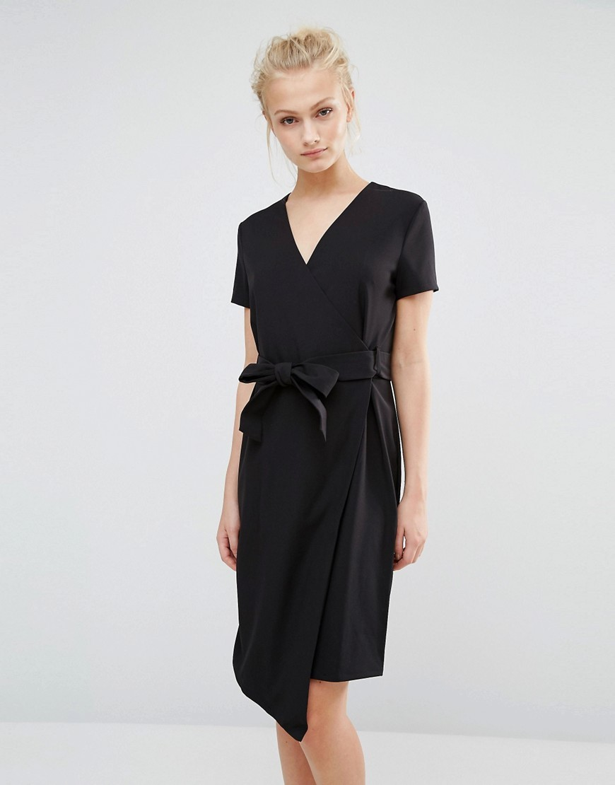 Belted Wrap Dress Black - style: faux wrap/wrap; neckline: v-neck; pattern: plain; waist detail: belted waist/tie at waist/drawstring; predominant colour: black; occasions: evening; length: on the knee; fit: body skimming; fibres: polyester/polyamide - stretch; sleeve length: short sleeve; sleeve style: standard; texture group: crepes; pattern type: fabric; season: a/w 2016; wardrobe: event
