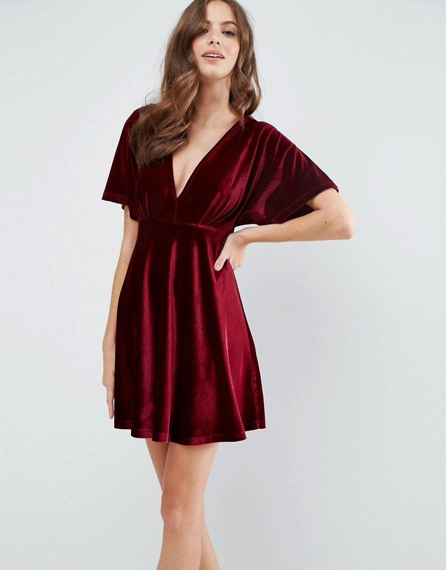 Velvet Kimono Plunge Mini Skater Dress Berry - length: mid thigh; neckline: v-neck; pattern: plain; sleeve style: kimono; predominant colour: burgundy; occasions: evening; fit: fitted at waist & bust; style: fit & flare; fibres: polyester/polyamide - stretch; sleeve length: half sleeve; pattern type: fabric; texture group: velvet/fabrics with pile; season: a/w 2016; wardrobe: event