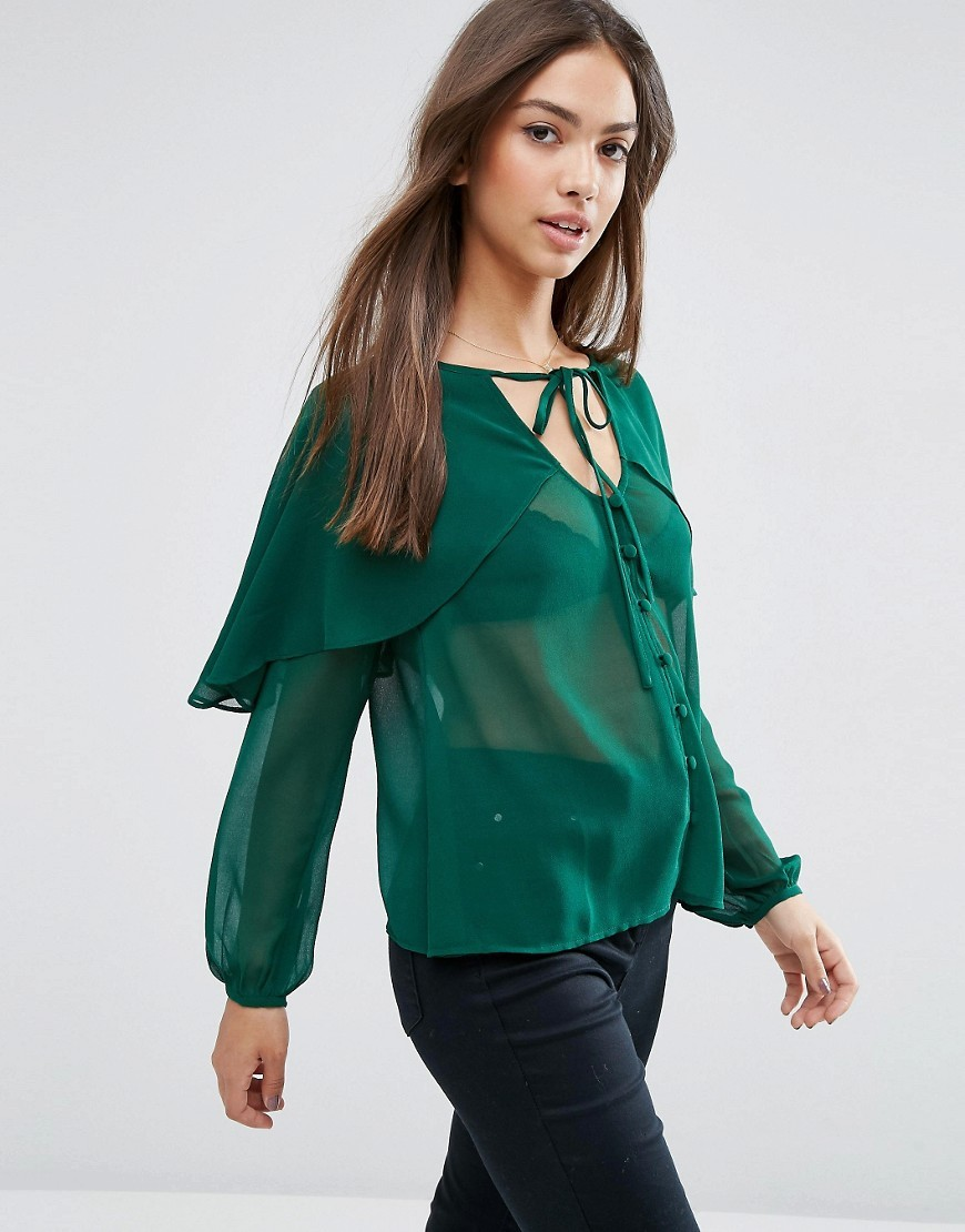 Blouse With Cape Detail & Tie Green - pattern: plain; neckline: pussy bow; style: blouse; bust detail: ruching/gathering/draping/layers/pintuck pleats at bust; predominant colour: emerald green; occasions: casual; length: standard; fibres: polyester/polyamide - 100%; fit: body skimming; sleeve length: long sleeve; sleeve style: standard; texture group: sheer fabrics/chiffon/organza etc.; pattern type: fabric; season: a/w 2016; wardrobe: highlight