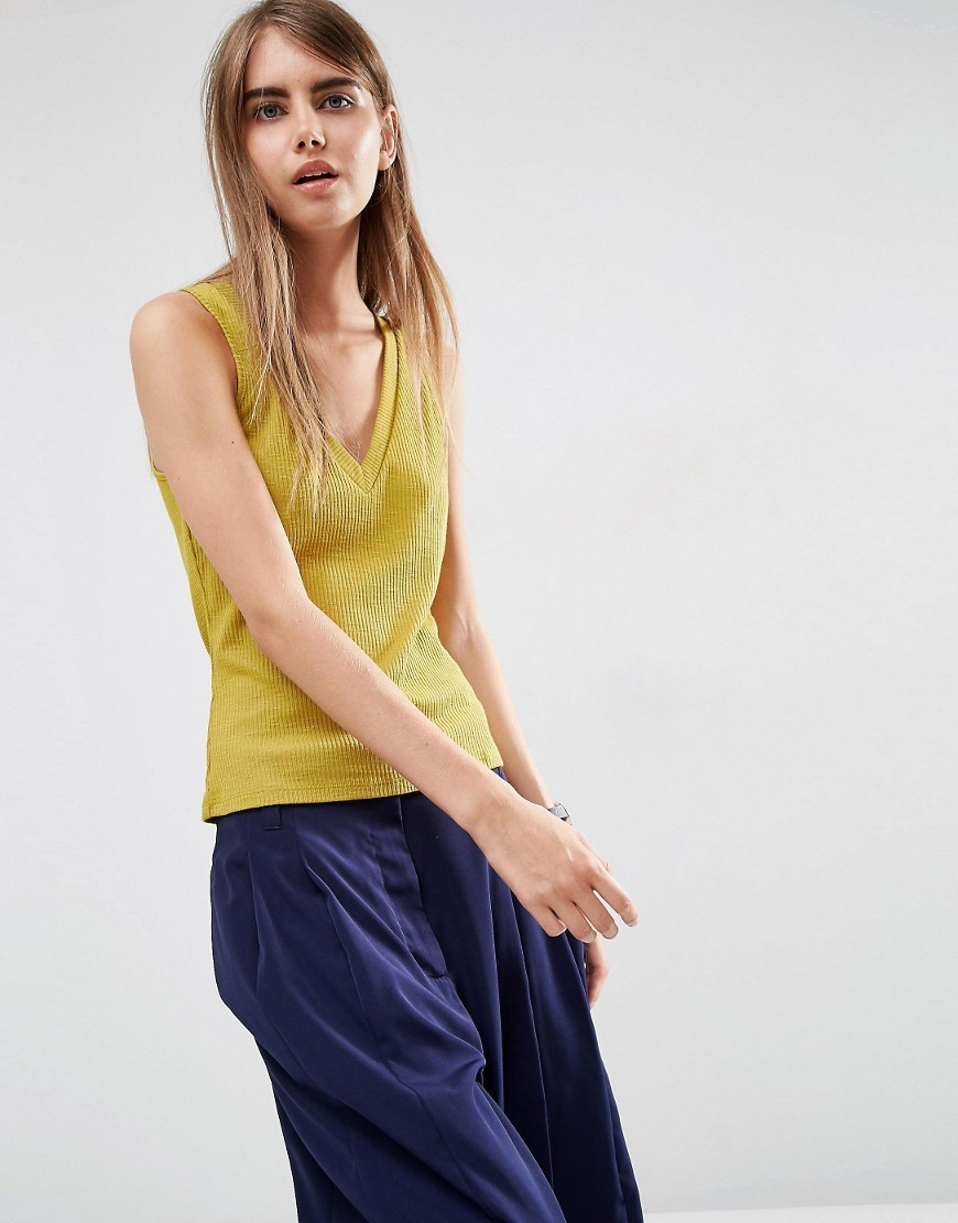 V Neck Slubby Rib Vest Yellow - neckline: v-neck; pattern: plain; sleeve style: sleeveless; style: vest top; predominant colour: yellow; occasions: casual; length: standard; fibres: cotton - mix; fit: body skimming; sleeve length: sleeveless; texture group: cotton feel fabrics; pattern type: fabric; season: a/w 2016; wardrobe: highlight